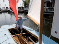 Robert Gallant sits in a restored wooden sail boat at the Pointe-Claire Yacht Club in Montreal on Monday August 17, 2015. Gallant helped restore the boat to its original glory and it is thought to be the only remaining boat from the original group of 23 Pointe-Claire One designed boats. The boats date back to 1933 when the club began acquiring them as racing boats.